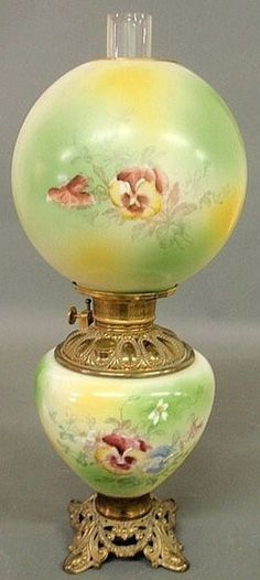 lighting, America, An unattributed brass Gone With the Wind oil parlor lamp, painted floral shade and base.  Circa 1876-1925