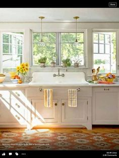 Oh. My. Gosh. It's my ideal sink set up! Farmhouse style sink set out a little from the cabinets with GIANT windows all along the wall behind. Switch out the cabinets and it's perfect! LOVE!