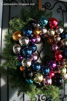 Christmas Wreath..I like the combination of a greenery wreath with the ball ornament wreath!