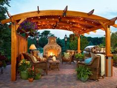 Not only is this beautifully designed structure an architectural focal point, it adds instant comfort on sunny days. Subtle bistro lights, an inviting fireplace, a grill station and cozy wicker furniture complete this outdoor room.