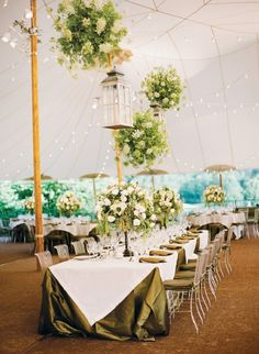 Elegant tented wedding reception with floral chandeliers | Katie Stoops Photography on @unitedwithlove via @aislesociety