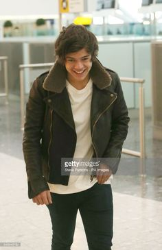 One Direction's Harry Styles arrives to catch a flight from Terminal 5 of Heathrow Airport.