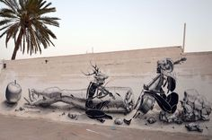 Graffiti decorates the wall of an old house in the Tunisian island of Djerba on July 29, 2014.