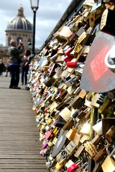 Pont de l'Archeveche in Paris (Love Lock Bridge). Couples, friends, or whatever the relationship status is, go to the bridge, write their names on a padlock, attach it to the bridge railing, then throw the key in the Seine River to symbolize their undying love.