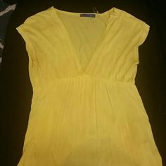 Yellow Short Sleeve Dress Shirt Low cut V neck and loose on the lower half! happie2 Tops Blouses