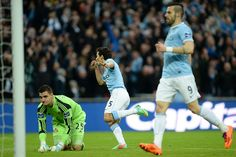 Manchester City 3 Sunderland 1: Capital One Cup Final at Wembley, with Jesus Navas wheeling away to celebrate City's third goal.