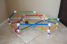 This is our DIY puppy play gym. We bought PVC pipes from formufit to create our gym. Read to find all the pieces needed to create one similar to ours. Best Puppies, Toy Puppies, Diy Baby Gym, Puppy Playpen, Puppy Litter, Dog Enrichment, Dog Playground, Puppy Classes, Puppy House