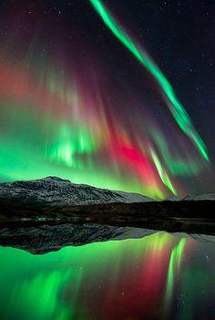 The Aurora Borealis, over Hogtuva Mountain in Norway