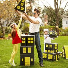 Create Super Hero City:Wrap a few big boxes in black paper and create windows, doors, and a roof with yellow sticky notes.