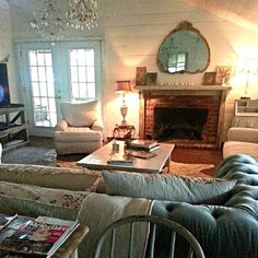 Shiplap, tufting, chandelier and a cozy fireplace