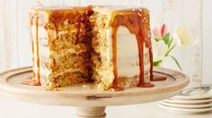 Traditional carrot cake studded with pecans, spread with sweet cream cheese frosting and topped with a layer of salted caramel sauce and sea salt becomes a showstopper dessert for any occasion.