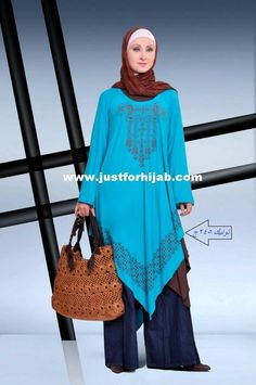 Hijab fashion with asymmetrical tunic top over wide-legged jeans