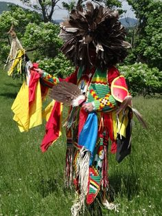 The Bald Eagle has a special place in the hearts and traditions of the descendants of Sparrowhawk and Sarah Persinger. Here one of their descendants wears beadwork featuring the Bald Eagle, a Bald Eagle hand fan and a headdress made from Bald Eagle and turkey feathers. Hidden in the design of the beadwork are the names in Cherokee of some of their family members.