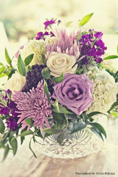 Not Your Grandmothers Crystal Wedding Centerpiece with lavender roses, lavender spider mums, white hydrangea, cream roses, purple stock, and purple trachelium