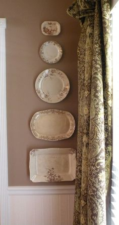 brown transferware ...love the platters on the wall