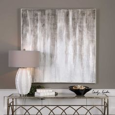 Designed by Carolyn Kinder International, the Straight and Narrow Wall Art features a heavily textured finish and is hand painted on canvas then stretched and attached to wooden stretchers. A narrow, silver gallery frame completes the outer edge. Due to the handcrafted nature of the artwork, each piece may have subtle differences. May be hung horizontal or vertical.