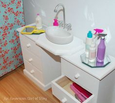 Love this DIY American Girl Doll bathroom sink made out of magnet holder from Target stationary section and wooden drawers from JoAnn.