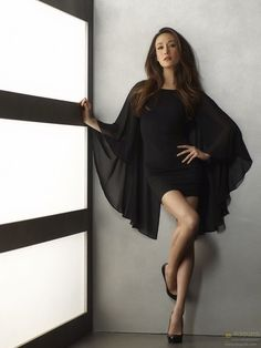 Little black dress.... Oh those sleeves. I dream of wearing this. *