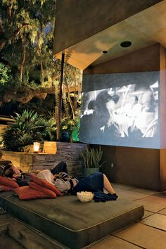 Movie night done right: daybed mattress on the floor, outdoor projector and lanterns.PHOTO: Erik Otsea.
