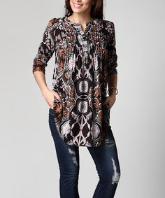 This neat pin tuck tunic is adorned with a bold abstract motif and carefully tailored to be both flowing and flattering. Its thick brushed fabric offers luxurious weight and warmth.Note: This is a one-of-a-kind item; prints may vary.Shipping note: This item is made to order.. Allow extra time for your special find to ship.