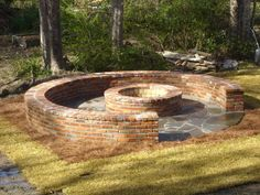 Brick and stone fire pit.