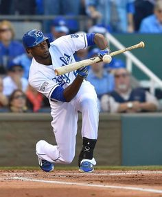 Kansas City Royals center fielder Lorenzo Cain bunts the ball for a single during the first inning at ALCS playoff baseball game on Wednesday October 15, 2014 at Kauffman Stadium in Kansas City, MO.