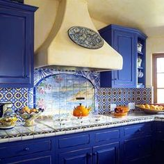 So love this Blue Kitchen!!! Not diggin' the backsplash/tile/countertops/fume-vent, but the cabinets are PERFECT!!!