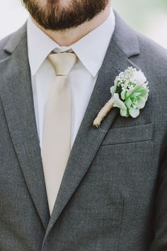succulent boutonniere, photo by With Love & Embers http://ruffledblog.com/ostertag-vistas-wedding #weddingideas #boutonnieres #grooms