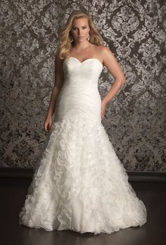 Brides.com: Designer Plus-Size Wedding Dresses We Love  | Click to view more styles
