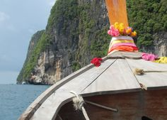 Long Tail Boat to the beach, Maya Bay on Ko Phi Phi, Krabi Thailand, Southeast Asia. For full guide on Krabi in Low season and travel check our blog http://live-less-ordinary.com/southeast-asia-travel/low-season-in-krabi-thailand