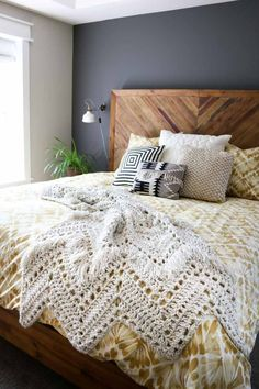 Gorgeous crochet blanket pattern with fringe. Perfect throw blanket to drape on a bed or chair!