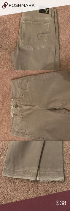 American Eagle jeans Grey American eagle skinny  jeans. Never worn with tags still on them. Size 2. Destruction at the bottom was made that way American Eagle Outfitters Jeans Skinny