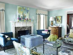 The celestial airiness of walls lacquered in Benjamin Moore's Antiguan Sky is grounded by a pair of Addison corner chairs from O. Henry House upholstered in Neptune-blue velvet — and covered in a Kravet fabric. Coffee table, Carole Gratale. Lamp, Christopher Spitzmiller.