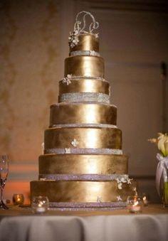 Beautiful tall metalic gold cake! #wedding #couturewedding #luxurywedding #weddingcake #goldwedding #goldweddingdecor #elegant