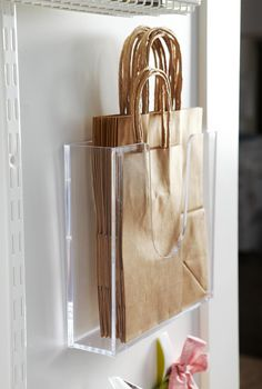 Behind the Door Storage Use Open Storage – Office supply stores are a treasure trove of mostly inexpensive storage items that help to keep things collated, vertical, horizontal, or divided. These clear plastic display caddies hold a collection of reusable Grocery Bag Storage, Gift Bag Storage, Plastic Bag Storage, Grocery Bags, Closet Organization, Kitchen Organization, Organization Ideas, Organizing Solutions, Closet Storage