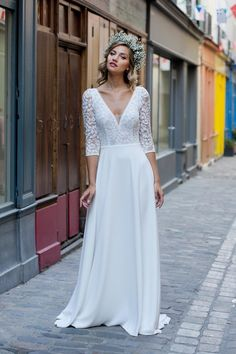 Vous rêvez d'une robe de mariée fluide et délicate ? Celle-ci sera parfaite pour vous sublimer le jour J. Découvrez notre sélection des plus beaux modèles de 2019. #aufeminin #mode #mariage #robedemariee