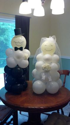Groom and bride balloon people made for a male co-worker's co-ed wedding shower. It took patience but I'm happy with the turn out.