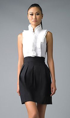Two-toned sleeveless minidress with pleated ruffle top and high-waisted bottom. A perfect day to evening dress!