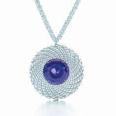 A floating galaxy of diamonds swirls around a magnificent tanzanite. Necklace with a 40.06-carat tanzanite and 300 diamonds in platinum.