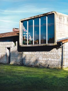Architect Matali Crasset converted a centuries-old farmhouse in the French countryside into a sleek modern home. The second-floor office ...