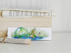 Excited to share this item from my #etsy shop: Swamp Mermaid Bookmark, Siren Bookmark, Green Mermaid, Wetland Mermaid, Mermaid Gifts, Bookish Gifts  #blondmermaid #bookishgifts #swampmermaid #mermaid #bookmarks #reading Mermaid Mermaid, Mermaid Gifts, Gifts For Readers, Altered Images, Bookmarks, Playroom, My Etsy Shop, Colours, Reading