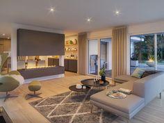 wohnzimmer mit kamin als raumteiler bungalow haus innen modern einrichten ideen fertighaus ambience 110 v3 von bien zenker hausbaudirekt de