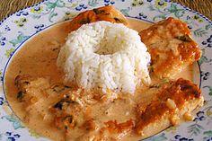 Pangasiusfilet in Weißwein - Sahnesoße mit Reis