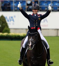 Thumbs up from Charlotte Dujardin on Valegro after another victory at the European Championships in Aachen, Germany, © 2015 Ken Braddick/dressage-news.com