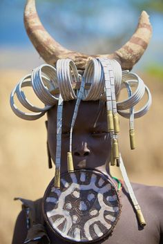 **Mursi tribe Ethiopia.   This is the only tribe in Africa that wears these lip plates.