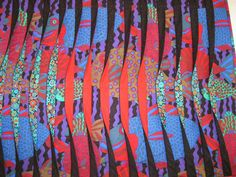 """""""Fish Kaffe"""" quilt by Virginia Koster, made with inserted manipulated strips forming a wave like pattern.  Technique by Caryl Bryer Fallert."""