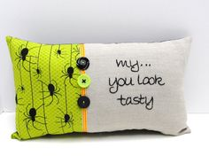 Halloween pillow with spiders.
