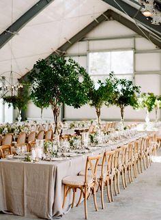 Decoración alta para las mesas de los invitados