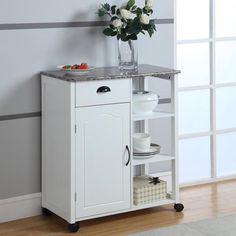 With a trendy yet practical design, this kitchen cart is the perfect addition to your household. Designed with spacious storage areas, this cart can store dishes, appliances, table sets and much more.
