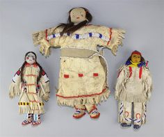 PLAINS BEADED AND FRINGED HIDE DOLLS